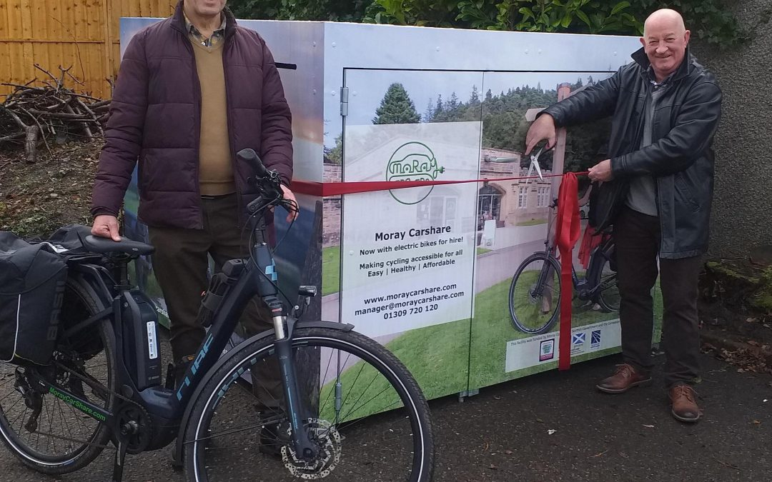 Councillor Derek Ross launches the new bike sharing service with Gordon McAlpine (Moray Carshare)